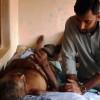 Reverend Dr Hamilton Inbadas working with a patient