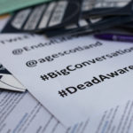 flyers and social media information at a death cafe for Death Awareness Week