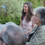 participants in a garden during a death cafe in Castle Douglas, Scotland