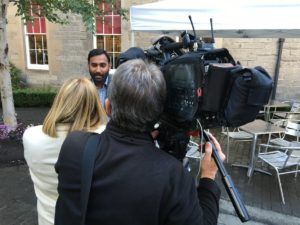 Hamilton Inbadas being interviewed by STV News crew