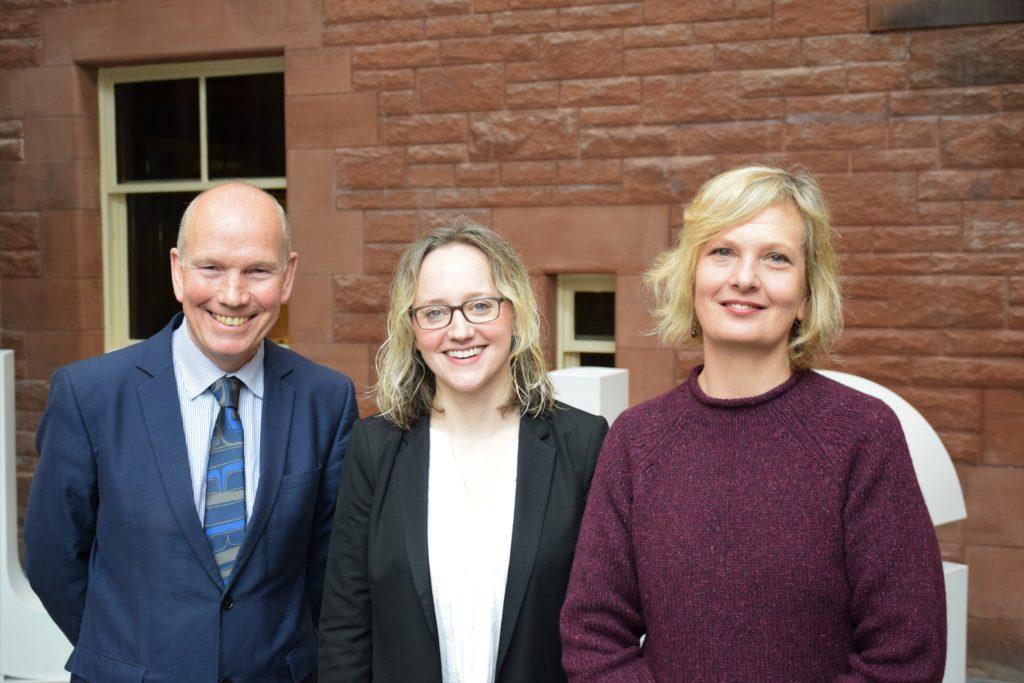 David Clark, Naomi Richards, Marian Krawczyk standing together facing camera